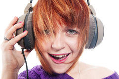 Yeah. Girl with headphones isolated on white Stock Images