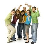 Yeah!. Group of 6 happy teenagers. They're standing with hands up and shouting. White background. Whole bodies visible Royalty Free Stock Photos