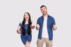 Yeah. Hooray. Portrait of yelling excited person students delighted impressed about their luck in lottery raising fists wearing royalty free stock image