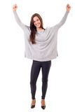Yeah! Sooo happy!. Studio shot: Happy woman with raised arms Stock Photos