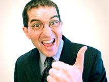 Yeah! (Success At Last!). Businessman giving an enthusiastic thumbs up royalty free stock photography
