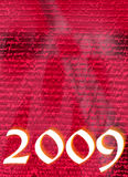 The year 2009. A image showing the year 2009 on a script red grunge background with a pale cross shape behind it Royalty Free Stock Photography