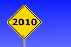 Year 2010. Yellow road sign with year 2010 and blue sky Royalty Free Stock Photo