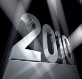 Year 2010. Silvery pedestal with number 2010 in sunbeams Stock Photos