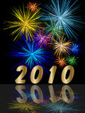 Year 2010. Numbers on reflective surface with beautiful and colored fireworks Royalty Free Stock Photo