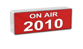 Year 2010 on air. Studio warning light on a white background Stock Image