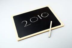 Year 2010 on a blackboard. 2010 written on blackboard with chalk Stock Image