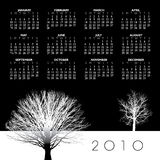 Year 2010 calendar. In black and white with leafless trees Royalty Free Stock Image