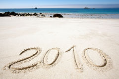 Year 2010 on sand Royalty Free Stock Photos