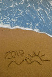 Year 2010 written on sand Stock Photos