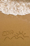 Year 2010 written on sand Royalty Free Stock Image