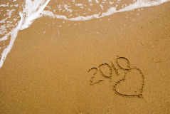 Year 2010 written on sand Stock Photo