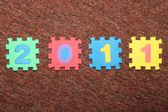 Year 2011. On the carpet, from colorful letter-puzzle Stock Images