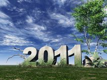 Year 2011. Stone monument 2011 under cloudy blue sky - 3d illustration Royalty Free Stock Photos
