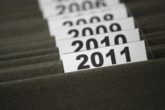 The year 2011 in index files. Tabs of an index file showing the year 2011, with older years partly covered in behind the first tab. Selective focus, so only the Royalty Free Stock Photography