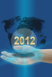 Year 2012. Hand hold Happy New Year 2012 with world map royalty free illustration