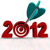 Year 2012 with Arrow in Target Bulls-Eye. The year 2012 in red numbers on a white background with a bullseye target in place of the zero and an arrow hitting the Royalty Free Stock Photos