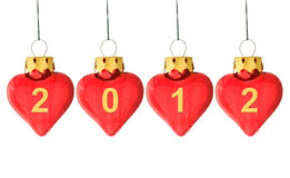 Year 2012 is coming!. Year 2012 is coming concept - 2012 written on several heart shaped christmas bauble isolated on white Stock Photo