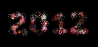 The year 2012 written in fireworks. Multiple bursts of colorful fireworks were used to write out the new year 2012 Stock Photography