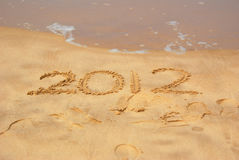 Year 2012 written in sand. The numbers of the year 2012 written in the sand on the holiday beach Royalty Free Stock Photography