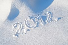 Year 2012 written in the Snow. Detail of Year 2012 written in the Snow Stock Photo