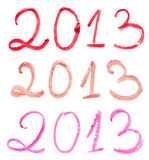 Year 2013. 2013 written with different lipsticks isolated on white background Stock Photos