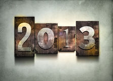 Year 2013 letterpress. The word 2013. Random letterpress type on grunge background Royalty Free Stock Images