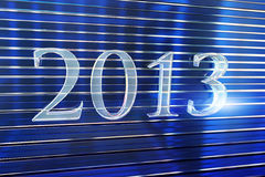 Year 2013 made of glass lettering. Blue text glass letters of 2013 with stripes dark blue background Stock Photo