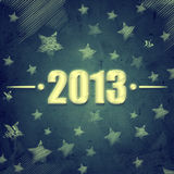 Year 2013 over blue retro background with stars Stock Photo