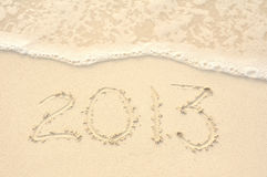 The Year 2013 Written in Sand on Beach Royalty Free Stock Photos