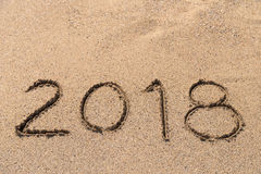 Year 2018 Written On Sand Royalty Free Stock Images