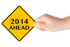 2014 year Ahead Sign. 2014 year Ahead traffic sign in woman's hand on a white background Vector Illustration