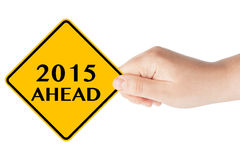 2015 year Ahead Sign. 2015 year Ahead traffic sign in woman's hand on a white background Royalty Free Stock Image