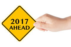 2017 year Ahead Sign. 2017 year Ahead traffic sign in woman's hand on a white background Royalty Free Stock Photos