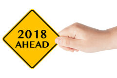 2018 Year Ahead Traffic Sign in Woman`s Hand. On a white background stock photo