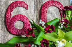 60 year anniversary decoration. Open book and flowers royalty free stock photos