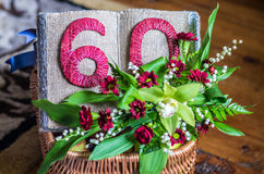 60 year anniversary decoration. Open book and flowers royalty free stock images
