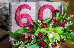 60 year anniversary decoration. Open book and flowers stock photo