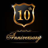 10 year anniversary golden label, 10th anniversary decorative golden emblem. Created 10 year anniversary golden label, 10th anniversary decorative golden emblem Stock Images