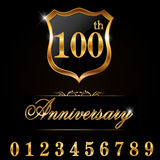 100 year anniversary golden label, 100th anniversary decorative golden emblem. Created 100 year anniversary golden label, 100th anniversary decorative golden Stock Photography