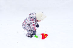 1 year baby playing in snow in winter Royalty Free Stock Photography