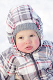 1 year baby with rosy cheeks in winter outdoors Stock Photos