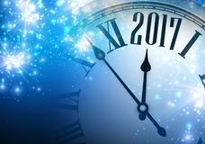 2017 year background with clock. 2017 year blue shining background with clock. Vector illustration Stock Photo