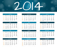 2014 year calendar. 2014 calendar in blue style with bokeh effect Stock Images
