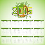 2015 Year calendar design. Beautiful  2015 calendar with stylish text, earth covered by leaves for save nature concept on shiny green background Stock Photos