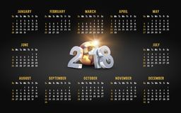 Year 2018 calendar. Year 2018 golden calendar on black background, starting on Sunday Stock Images
