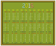 Year 2015 Calendar. An illustration of a calendar for the year 2015 on a green blackboard. A custom handwritten font is used and the image is isolated on white Stock Photos