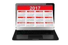 2017 Year Calendar over Laptop Screen. 3d Rendering. 2017 Year Calendar over Laptop Screen on a white background. 3d Rendering Stock Photo