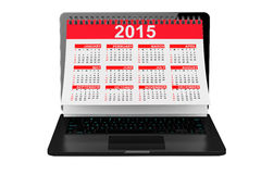 2014 year calendar over laptop screen. On a white background Stock Photo