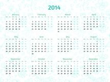 2014 Year calendar on patterned floral background. Cold green and aquamarine tints Stock Image